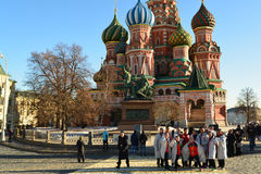 Moscow, Russia -February 18.2016. Tourists are photographed against the backdrop of St Basil's Cathedral Stock Image