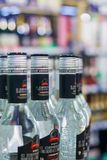 View of a glass bottles of russian vodka in the store. Moscow, Russia, February, 2018: View of a glass bottles of russian vodka in the store in the foreground Royalty Free Stock Photos