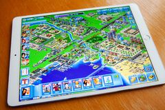 Moscow / Russia - February 25, 2019: White ipad lies on the table. On the screen game megapolis. royalty free stock images