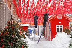 Workers decorate Tverskaya Square with red ribbons and garlands for Russian national festival `Shrove` in Moscow. Moscow, Russia - February 08, 2018: Workers royalty free stock photography