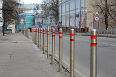 Moscow, Russia. Fence of  columns along the road in the alley Gorokhovskii. Moscow, Russia. Fence of the columns along the road in the alley Gorokhovskii Royalty Free Stock Photo