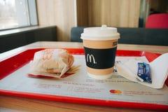 Moscow, Russia - 11 18 2018: Hamburger menu in McDonald`s restaurant, coffee, cheeseburger. Fastfood, junk food concept royalty free stock photography