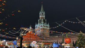 Moscow, Russia - January 1, 2020: Christmas fair on the red square against the background of the Kremlin.