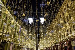 Christmas and New Year on Nikolskaya Street. Light installations in the winter frosty evening stock image