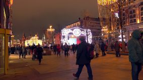 MOSCOW, RUSSIA - JANUARY 2, 2018. Crowded Tverskaya street and distant Kremlin decorated for Christmas and New Year in. MOSCOW, RUSSIA - JANUARY 2, 2018. Crowded stock video