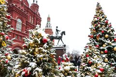 Moscow, Russia - January 5, 2018: Moscow Festival Journey to Christmas . Illuminated New Year trees on Manezhnaya Square. In front of Historical Museum and Royalty Free Stock Images