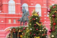 Moscow, Russia - January 9, 2018: Moscow Festival Journey to Christmas . Illuminated New Year trees on Manezhnaya Square. In front of Historical Museum and Stock Photos