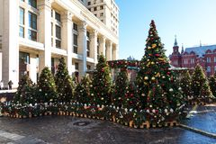 Moscow, Russia - January 9, 2018: Moscow Festival Journey to Christmas . Illuminated New Year trees on Manezhnaya Square. In front of Historical Museum Stock Image