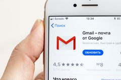 MOSCOW, RUSSIA - JANUARY 08, 2018: Hand holding Apple Iphone 7s with Google Gmail application icon. Gmail app icon in app store. stock photos