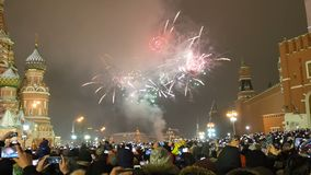 Moscow, Russia -January 1, 2019: Many people gathered for a universal celebration New Year`s in Moscow. Fireworks on Red. Square near the Spasskaya Tower on New stock footage