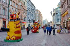 Arbat street in a festive New year`s days, Moscow, Russia. Moscow, Russia - January 9, 2018: New year in Moscow. Cartoon figures on Arbat street Stock Photography