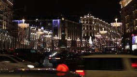 Night car traffic view on central Tverskaya street in Moscow, Russia. Moscow, Russia - January, 2017: Night car traffic view on central Tverskaya street in stock footage