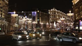Night car traffic view on central Tverskaya street in Moscow, Russia. Moscow, Russia - January, 2017: Night car traffic view on central Tverskaya street in stock video