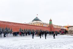 Moscow, Russia - January 5, 2018: People are walking on Red Square during the winter holidays in Moscow, Russia. Moscow, Russia - January 5, 2018: People are Stock Image