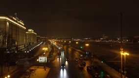 MOSCOW, RUSSIA - JANUARY, 13, 2017. Russian MOD, ministry of defence at night and traffic on river embankment. 4K video. MOSCOW, RUSSIA - JANUARY, 13, 2017 stock video