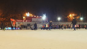 MOSCOW, RUSSIA - JANUARY 1, 2017: Skating rink in the open air. People skate in the winter. Evening time. Christmas stock footage