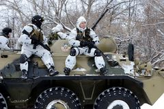Soldiers special unit on the armored personnel carrier. MOSCOW, RUSSIA - JANUARY 20, 2016: Soldiers special unit on the armored personnel carrier royalty free stock images