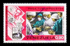 Medicine, `Pay your taxes` campaign serie, circa 1974. MOSCOW, RUSSIA - JANUARY 2, 2018: A stamp printed in Venezuela shows Medicine, `Pay your taxes` campaign Royalty Free Stock Image