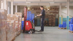 MOSCOW RUSSIA - Jule 17: Forklift Truck Driver Pallet Storage Warehouse. MOSCOW RUSSIA - Jule 17: Forklift Truck Driver unloading Pallet In Storage Warehouse stock video footage