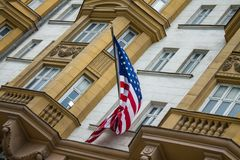 Moscow / Russia - July, 18, 2019: American flag closeup on U.S. Embassy building royalty free stock photography