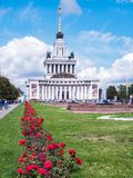 Moscow, Russia - July 2016: Central Pavilion VDNKh. Historical and cultural monument of national significance. Blooming. Red roses and fountains in the stock photo
