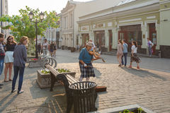 Moscow, Russia, July 24, 2016 Festival Moscow Summer. An elderly woman with a violin on Kuznetsky Most royalty free stock image