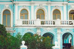 Fragment of a beautiful old blue building with a balcony in the street of Moscow. royalty free stock photography