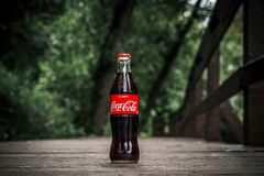 MOSCOW, RUSSIA - JULY 12, 2019: Glass bottle of coke outdoors. stock images