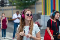 MOSCOW, RUSSIA - JULY 22, 2018: A group of young people in multi-colored headphones SONY h.ear on gathered for party. Near metro Savelovskaya. Remote Moscow is stock photo