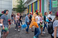 MOSCOW, RUSSIA - JULY 22, 2018: A group of young people in multi-colored headphones SONY h.ear on gathered for quest party. MOSCOW, RUSSIA - JULY 22, 2018: A stock photos