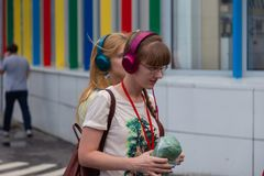 MOSCOW, RUSSIA - JULY 22, 2018: A group of young people in multi-colored headphones SONY h.ear on gathered for quest party. MOSCOW, RUSSIA - JULY 22, 2018: A royalty free stock photo