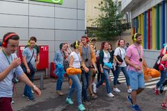 MOSCOW, RUSSIA - JULY 22, 2018: A group of young people in multi-colored headphones SONY h.ear on gathered for quest party. MOSCOW, RUSSIA - JULY 22, 2018: A royalty free stock photos