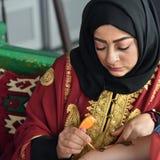 Mehndi henna tattoo. A henna or mehndi applier at work stock photography