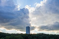 Moscow / Russia - July 23, 2013: a lonely tall building against the backdrop of trees and a stormy sky. royalty free stock photography