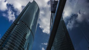 MOSCOW, RUSSIA - July, 13, 2016. Moscow city business area skyscrapers and Novotel hotel 4K hyperlapse. View from below stock video