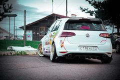 Moscow, Russia: July 06, 2019: Moscow, Russia: July 06, 2019: Bright white lowered volkswagen golf mk7 with aerography parked on