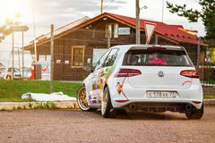 Moscow, Russia: July 06, 2019: Moscow, Russia: July 06, 2019: Bright white lowered volkswagen golf mk7 parked on street in sunny