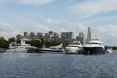 Motor yachts are moored in a parking lot at the Khimki Reservoir in Moscow. Royalty Free Stock Image