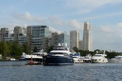 Motor yachts are moored in a parking lot at the Khimki Reservoir in Moscow. Stock Photos