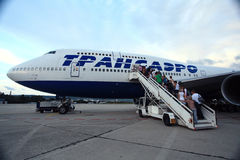Moscow, RUSSIA - JULY 28: Passengers boarding a plane on July 28, 2014 Royalty Free Stock Photo