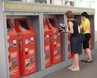 MOSCOW, RUSSIA. People buy suburban tickets in automatic machines at the Belarusian station. The Russian text - sale of suburban t stock images