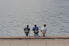 Rear view of lifeguards sitting in a chair near the water on the banks of the Moscow River in Moscow royalty free stock photography