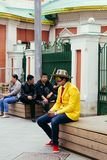 The sad Columbian fan sitting on a bench, texting after defeat o royalty free stock photo