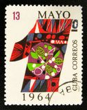 Colorful digit, devoted to Labour day 1st may, circa 1964. MOSCOW, RUSSIA - JULY 15, 2017: A stamp printed in Cuba shows colorful digit, devoted to Labour day Stock Image