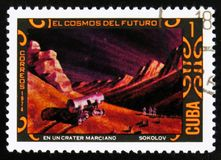 Futurisric cosmic scenery, the series `Cosmos of the future - Martian crater paintings by A. Sokolov`, circa 1974. MOSCOW, RUSSIA - JULY 15, 2017: A stamp Stock Image