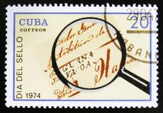 Loupe and letter, devoted to Day of the seal, Guana Vacoa, circa 1974. MOSCOW, RUSSIA - JULY 15, 2017: A stamp printed in Cuba shows Loupe and letter, devoted to Royalty Free Stock Photography