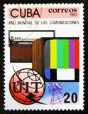 TV set, radio, globe and emblem, Year of comunication, circa 1983. MOSCOW, RUSSIA - JULY 15, 2017: A stamp printed in Cuba shows TV set, radio, globe and emblem Royalty Free Stock Images
