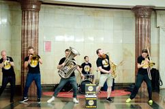 Street musicians play musical instruments on the metro station in the city of Moscow royalty free stock images