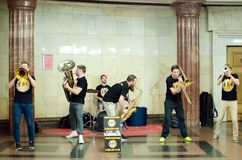 Street musicians play musical instruments on the metro station royalty free stock photo