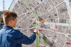 Moscow, Russia - July 24. 2017. Teenager looks at city map. Moscow, Russia - July 24. 2017. A teenager looks at a city map royalty free stock image